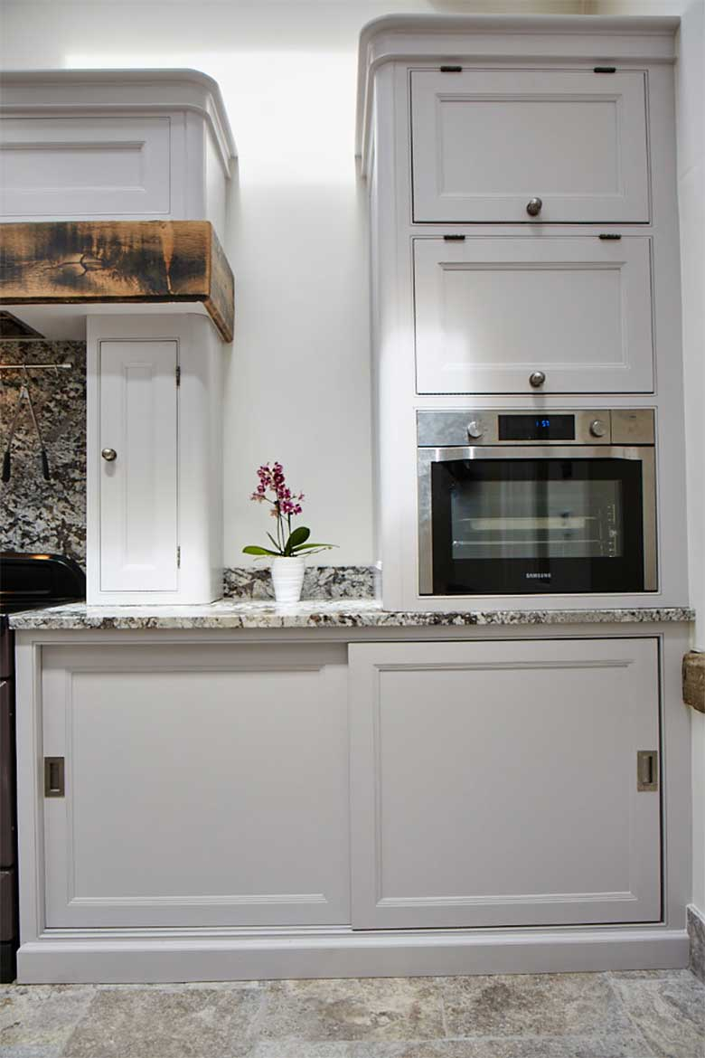 Sliding door painted cabinets with integrated microwave