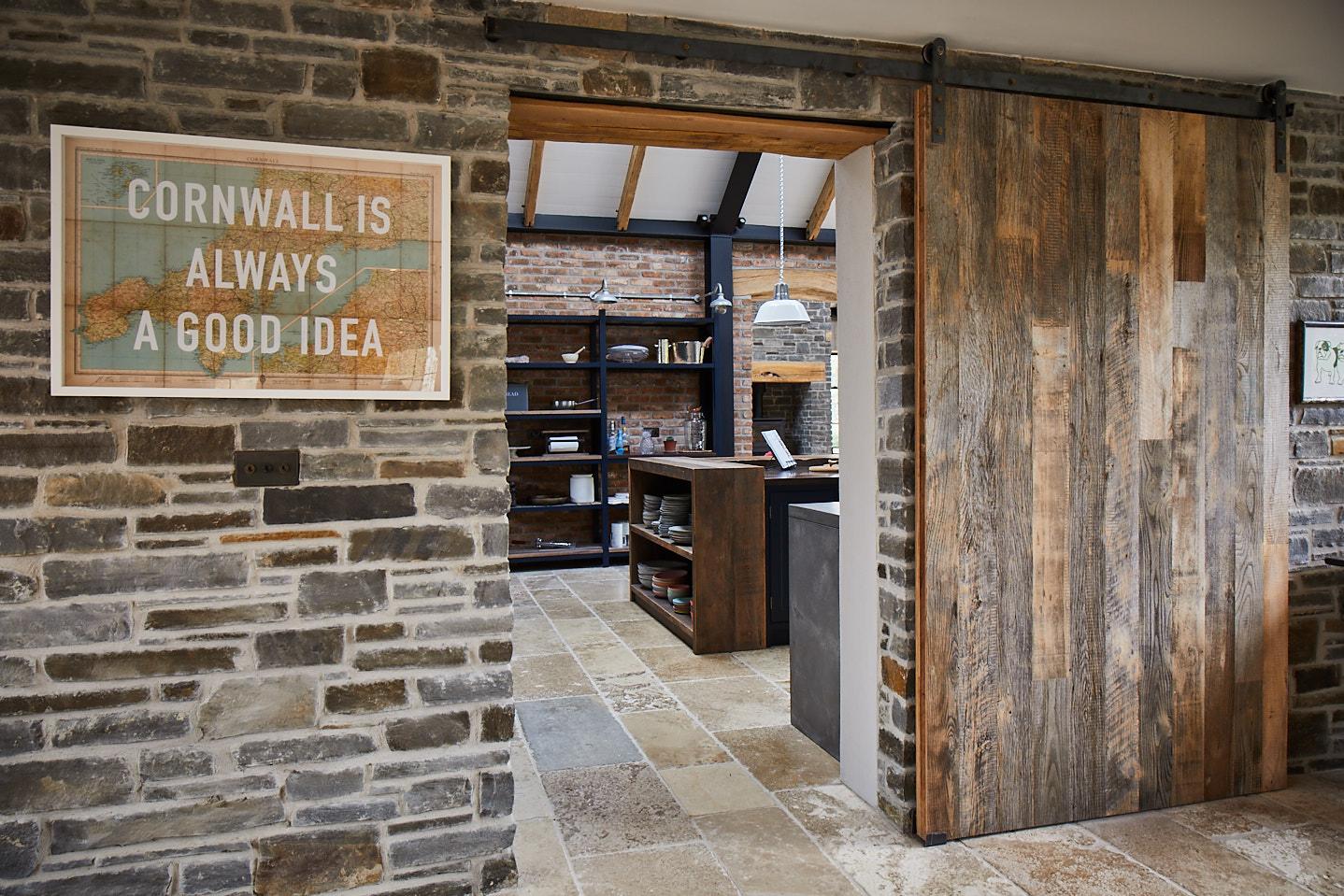 Cornwall is always a good idea sign with The Main Company sliding barn door