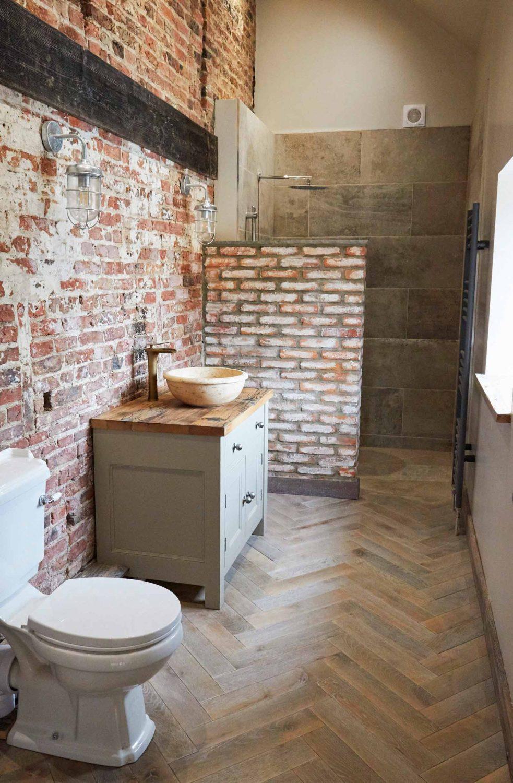 Oak herringbone flooring in bathroom