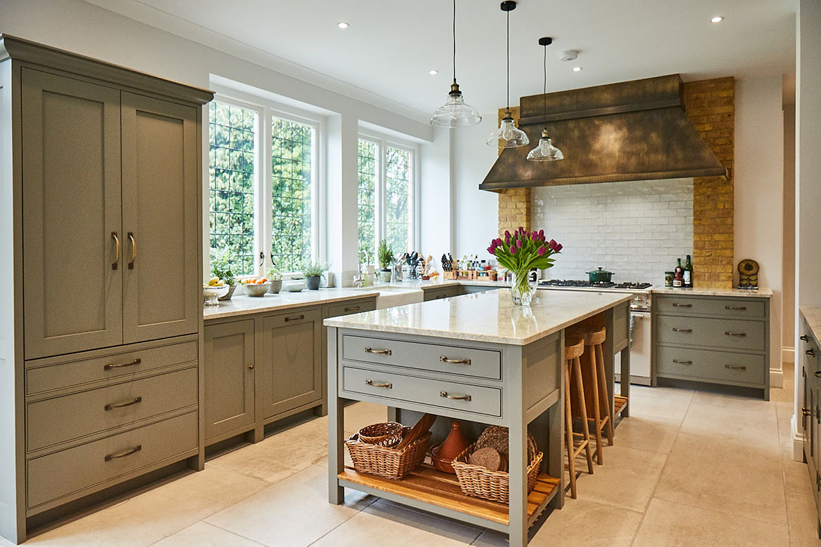 Little Greene grey moss kitchen island with solid oak pot board end and granite worktops