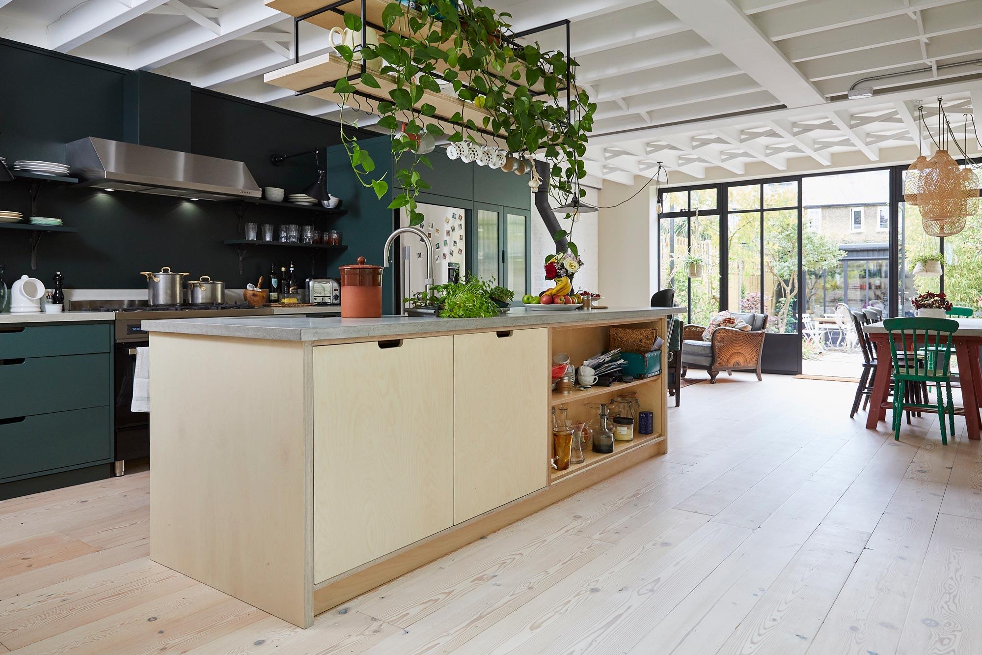 Birch plywood kitchen island with solid concrete worktops
