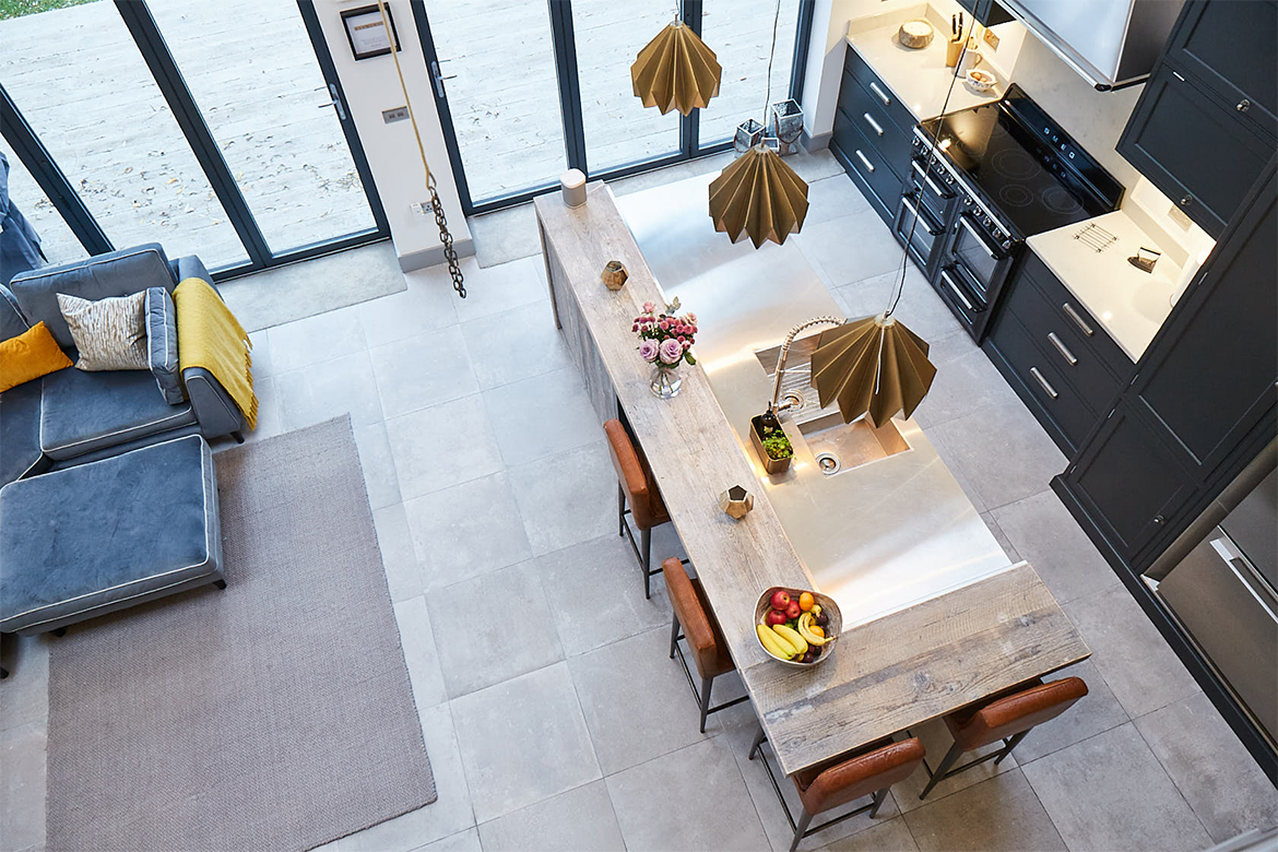 Ariel shot of kitchen island with reclaimed wrap around wood breakfast bar and stainless steel worktop