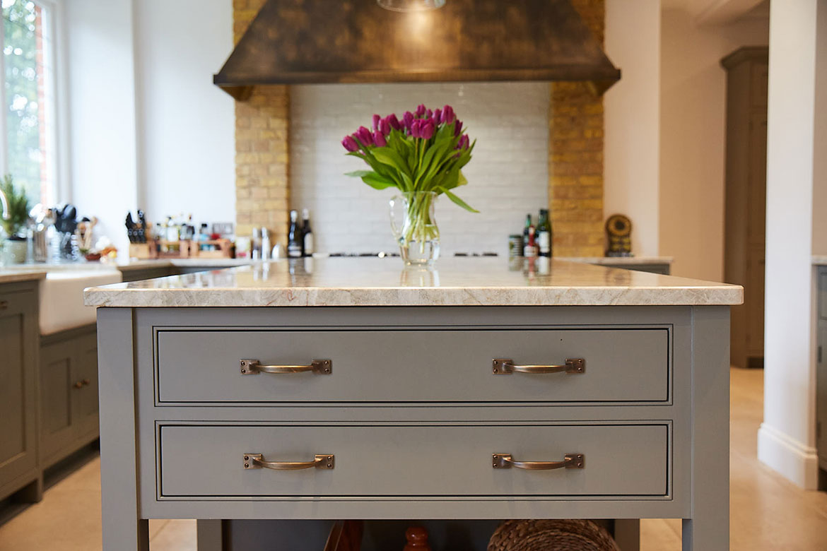 Two drawers in pot board island end with Centaurus grey granite painted grey moss by Little Greene