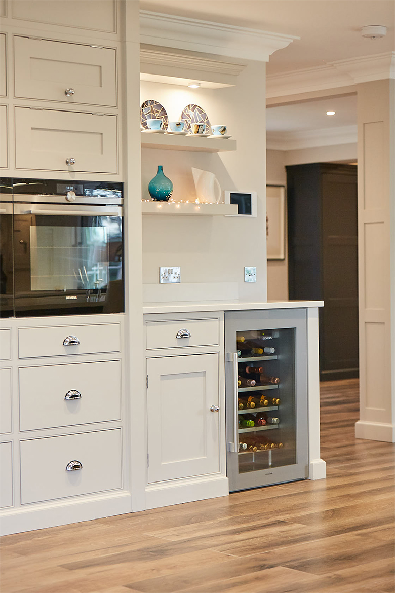 Semi integrated stainless wine cooler with white granite worktop