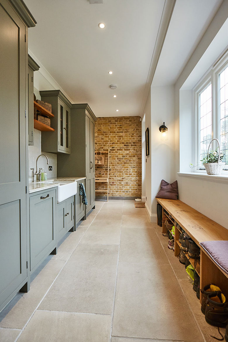 Utility with exposed yellow London brick wall, belfast sink and solid oak shoe storage