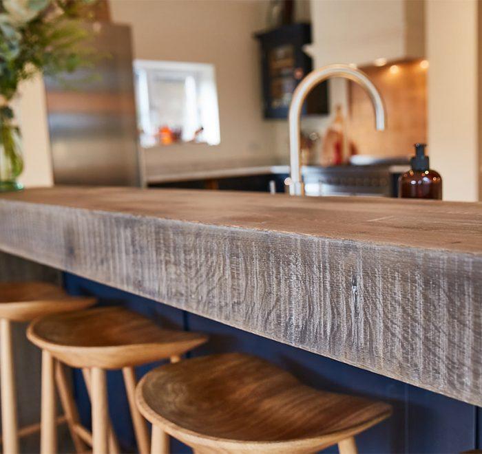 Band sawn oak breakfast bar and clean solid oak wooden bar stools