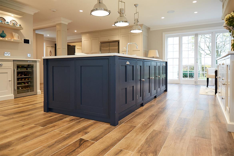 Wood floor with Little Greene blue painted kitchen island and Centaurus grey granite worktop