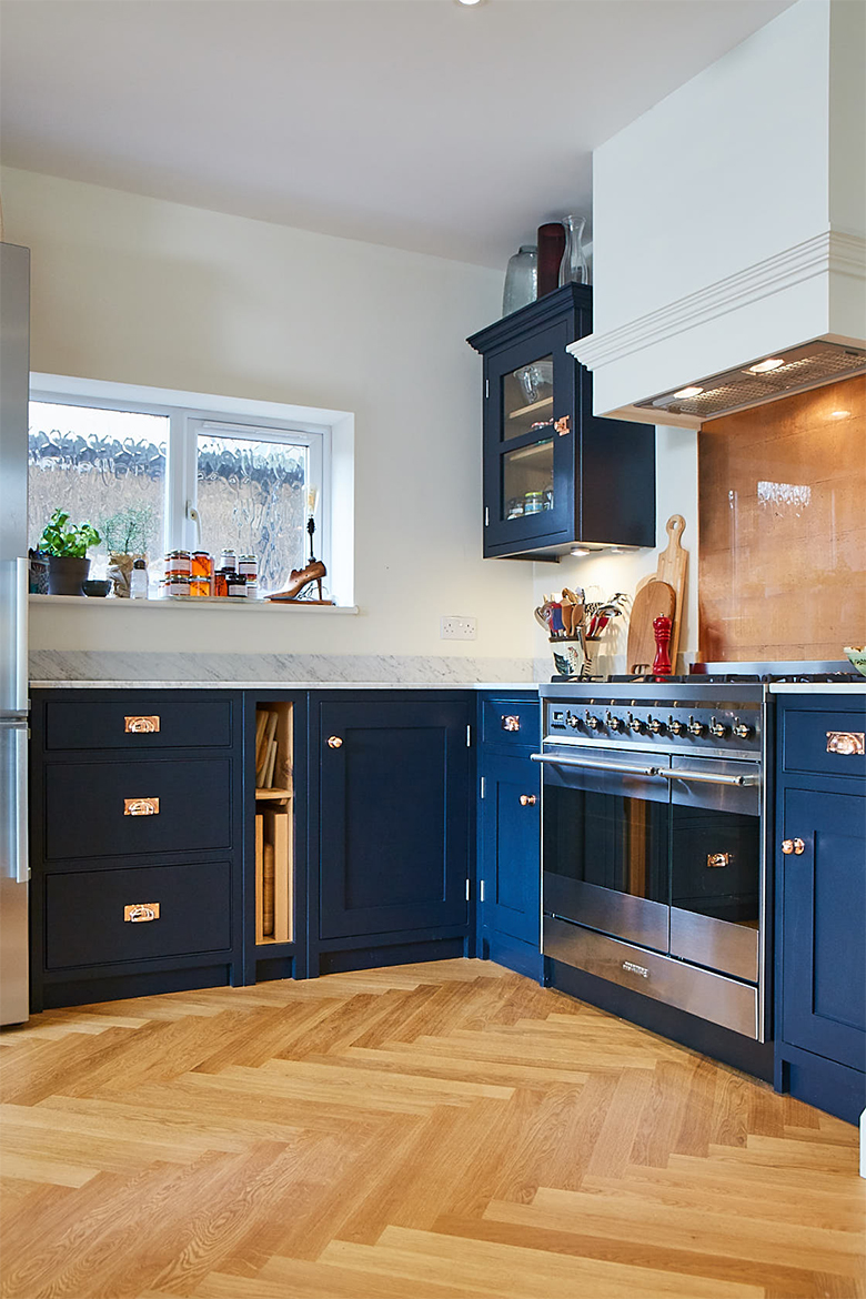 Cooker run painted in dark blue with tray space and pan drawer units
