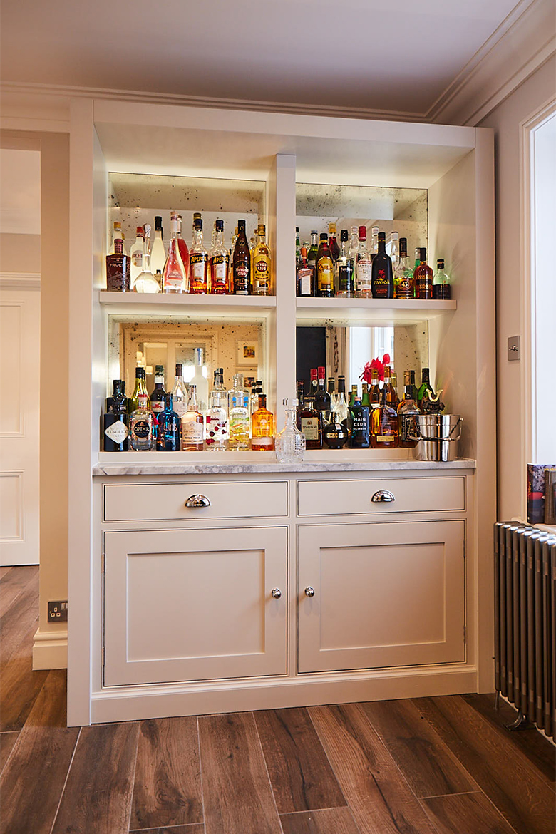 Bespoke painted shaker drinks cabinet with aged mirror back drop