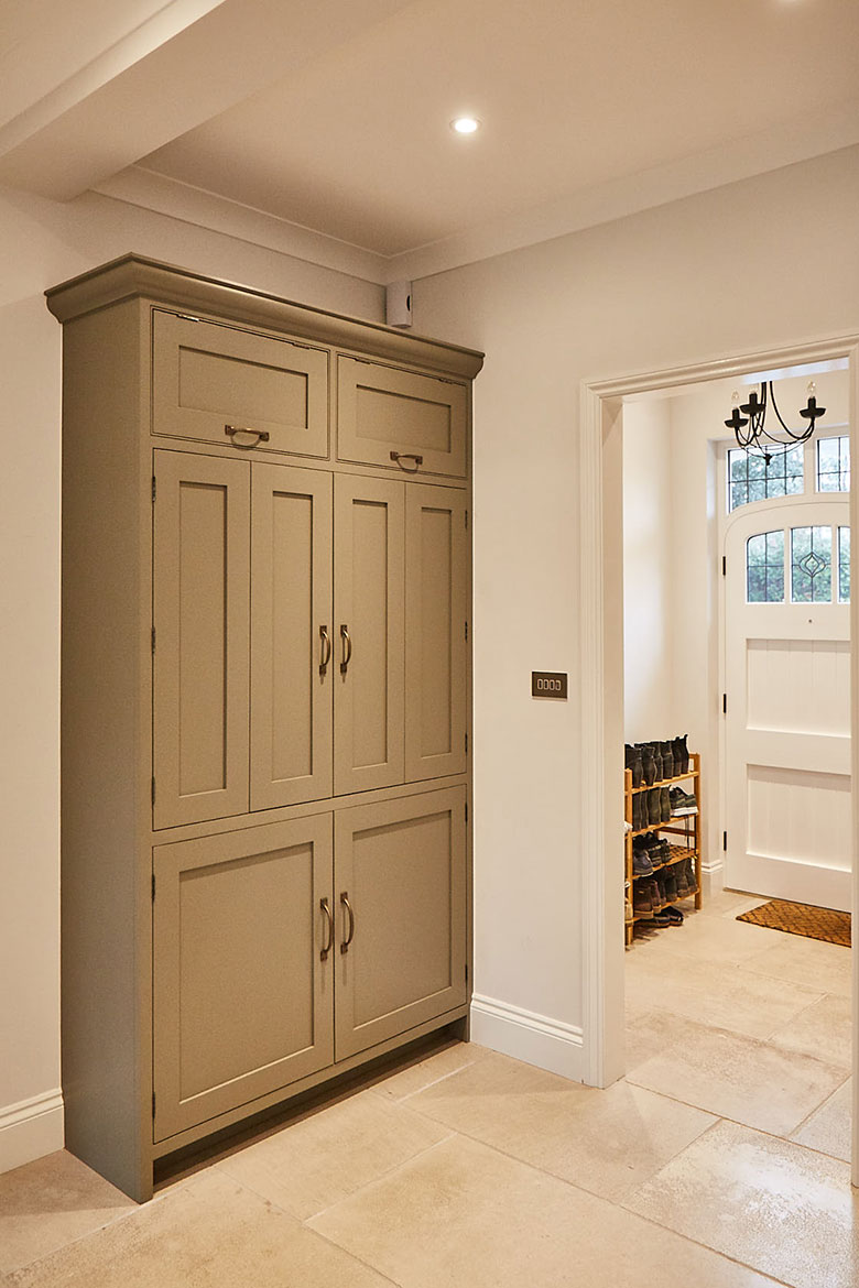 Single traditional bi-fold tall unit next to front door