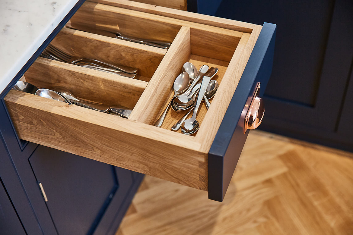 Top drawer of kitchen unit with bespoke solid oak insert to separate cutlery