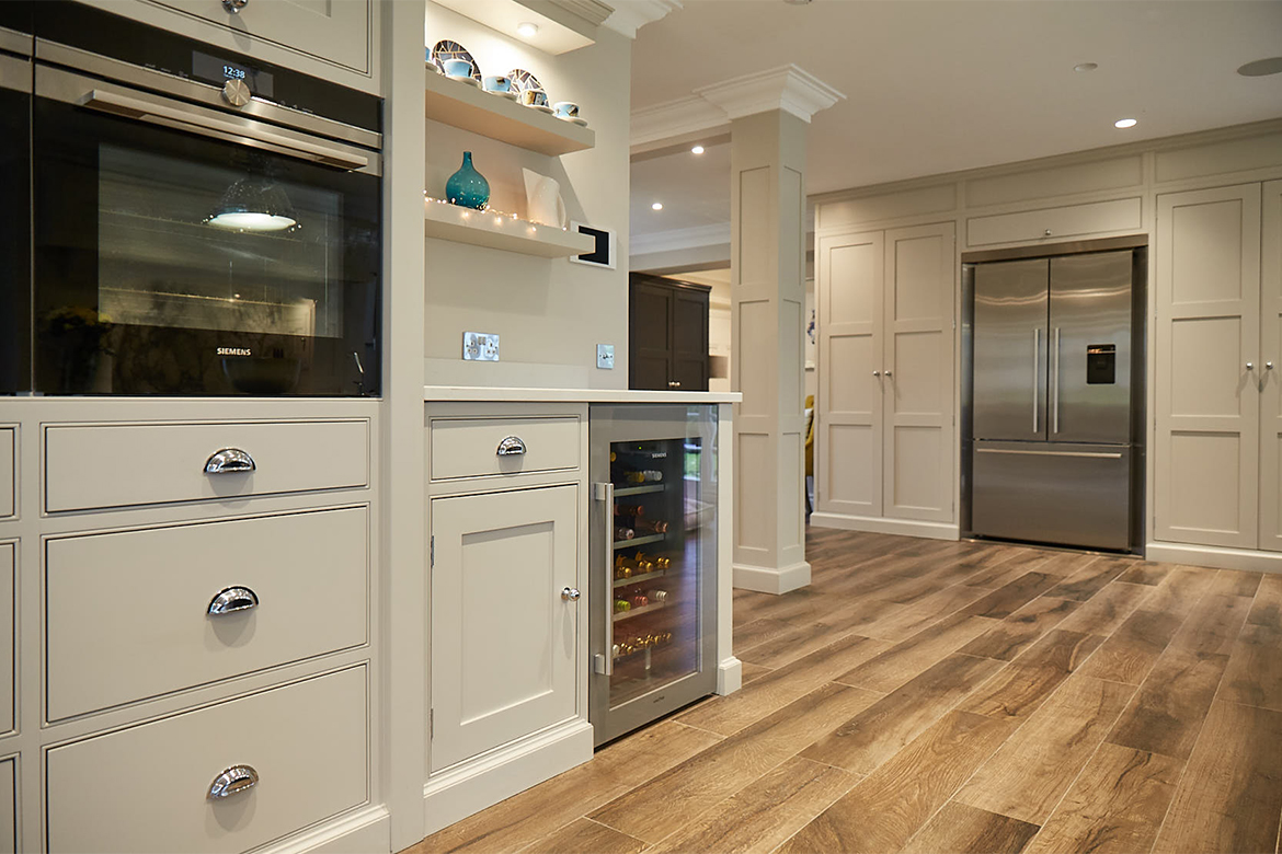 Wine cooler and American stainless fridge freezer integrated in to shaker grey cabinets
