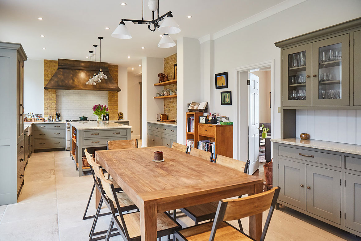 Rustic wood table and chairs with metal frame in open plan traditional London kitchen