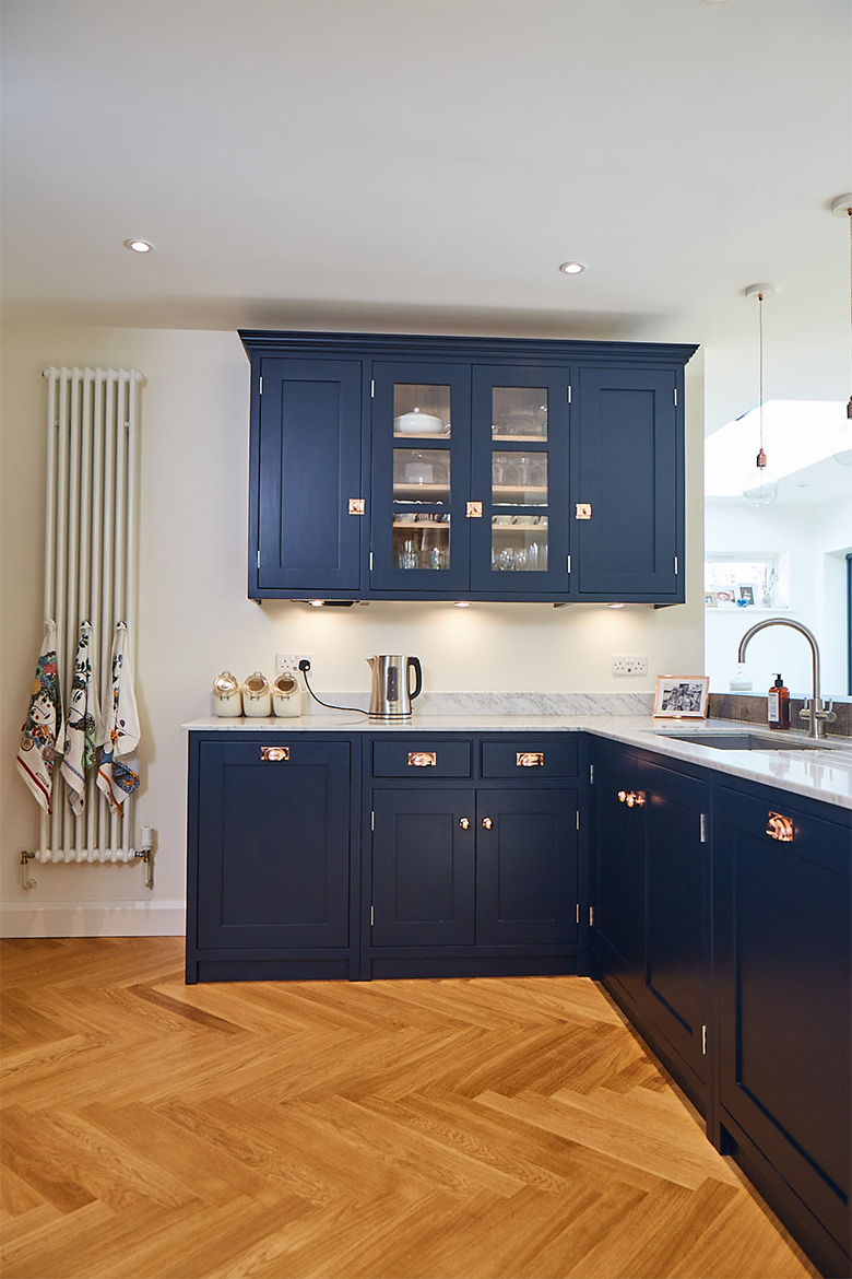 Bespoke painted wall cabinets with glass double doors in centre painted in basalt by Little Greene