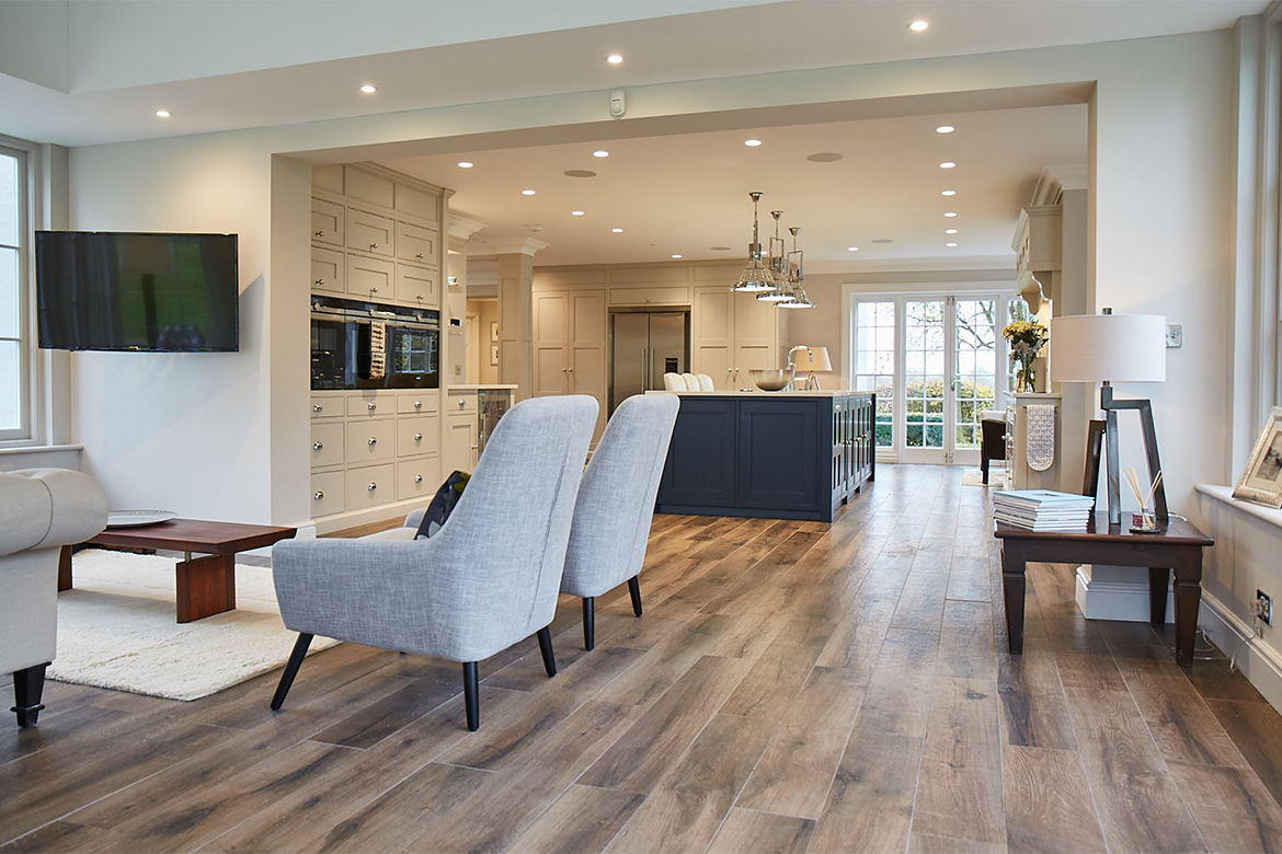 Occasional grey upholstered chairs in open plan kitchen