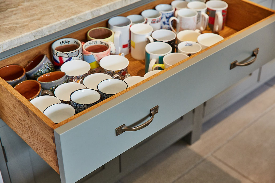 Solid oak drawer pox with painted front holds collection of mugs in pot board