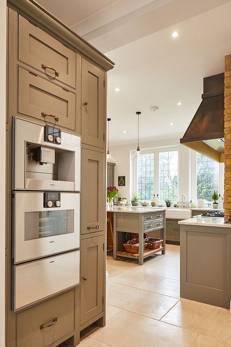 Gaggenau coffee machine, oven and warming drawer at eye level in grey moss Little Greene bespoke cabinets