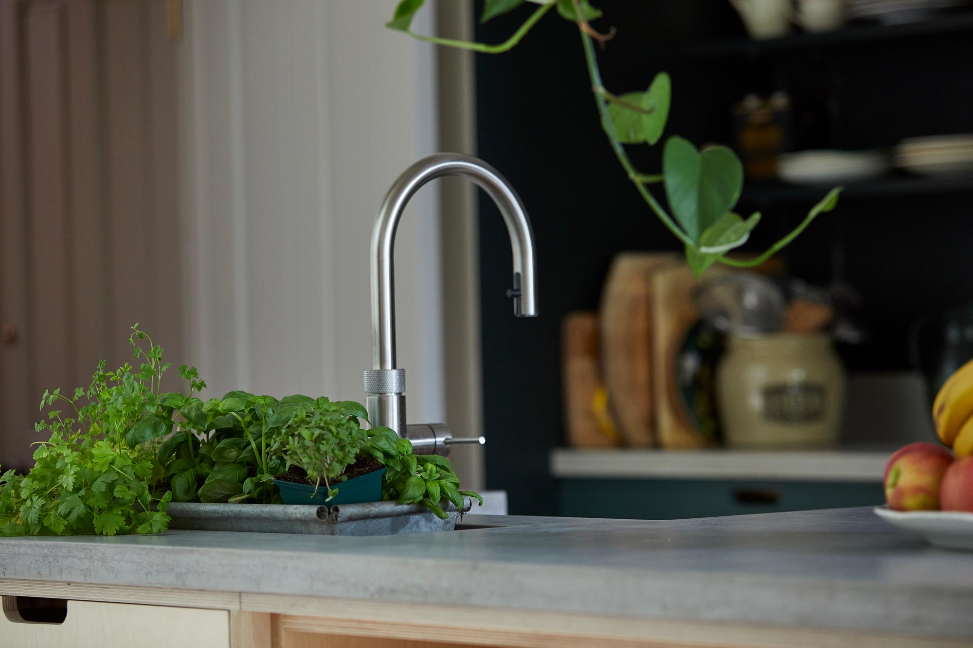 Brushed stainless Quooker hot water tap on concrete worktop