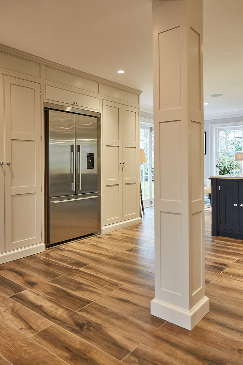 Tall painted cabinets with integrated Fisher & Paykel stainless steel fridge freezer