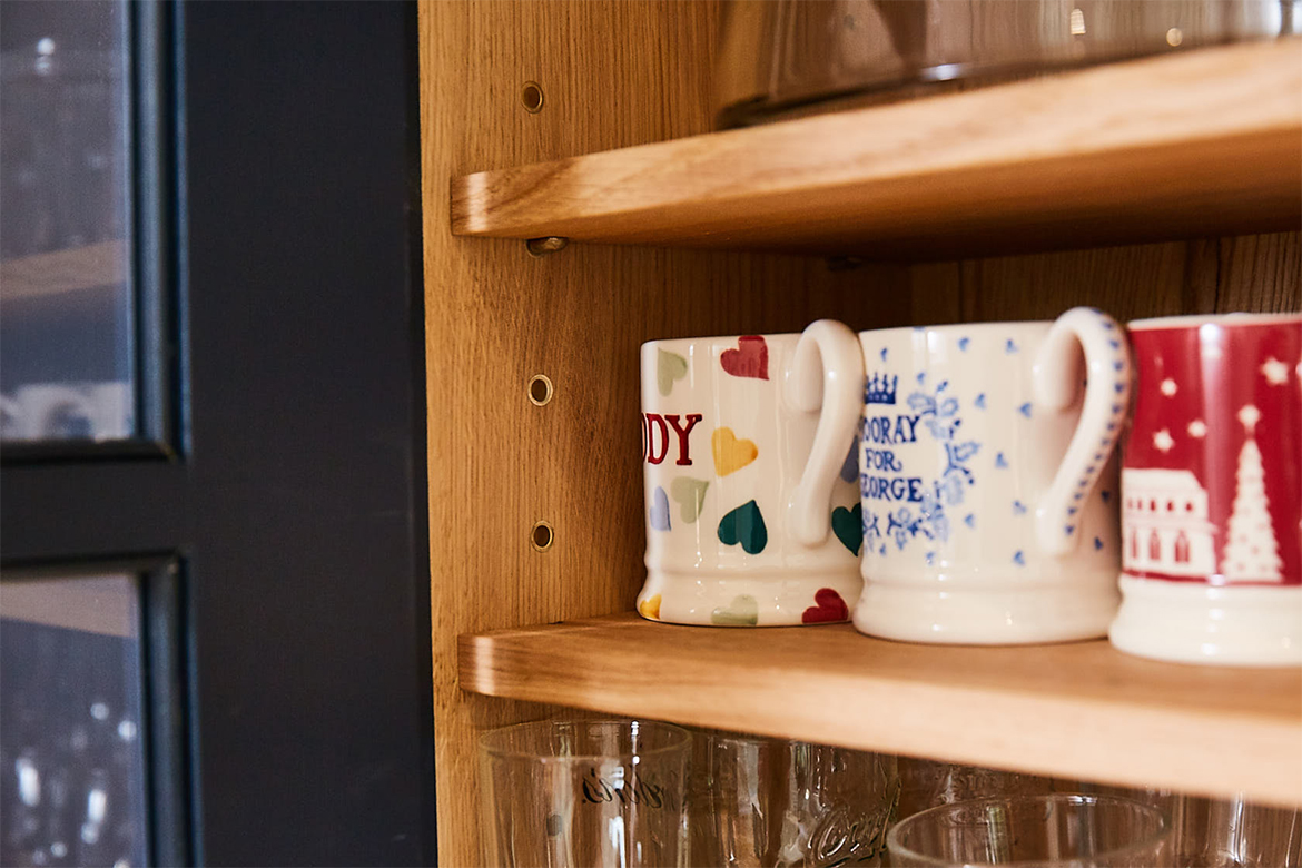 Solid oak wall unit with Emma Bridgewater mugs