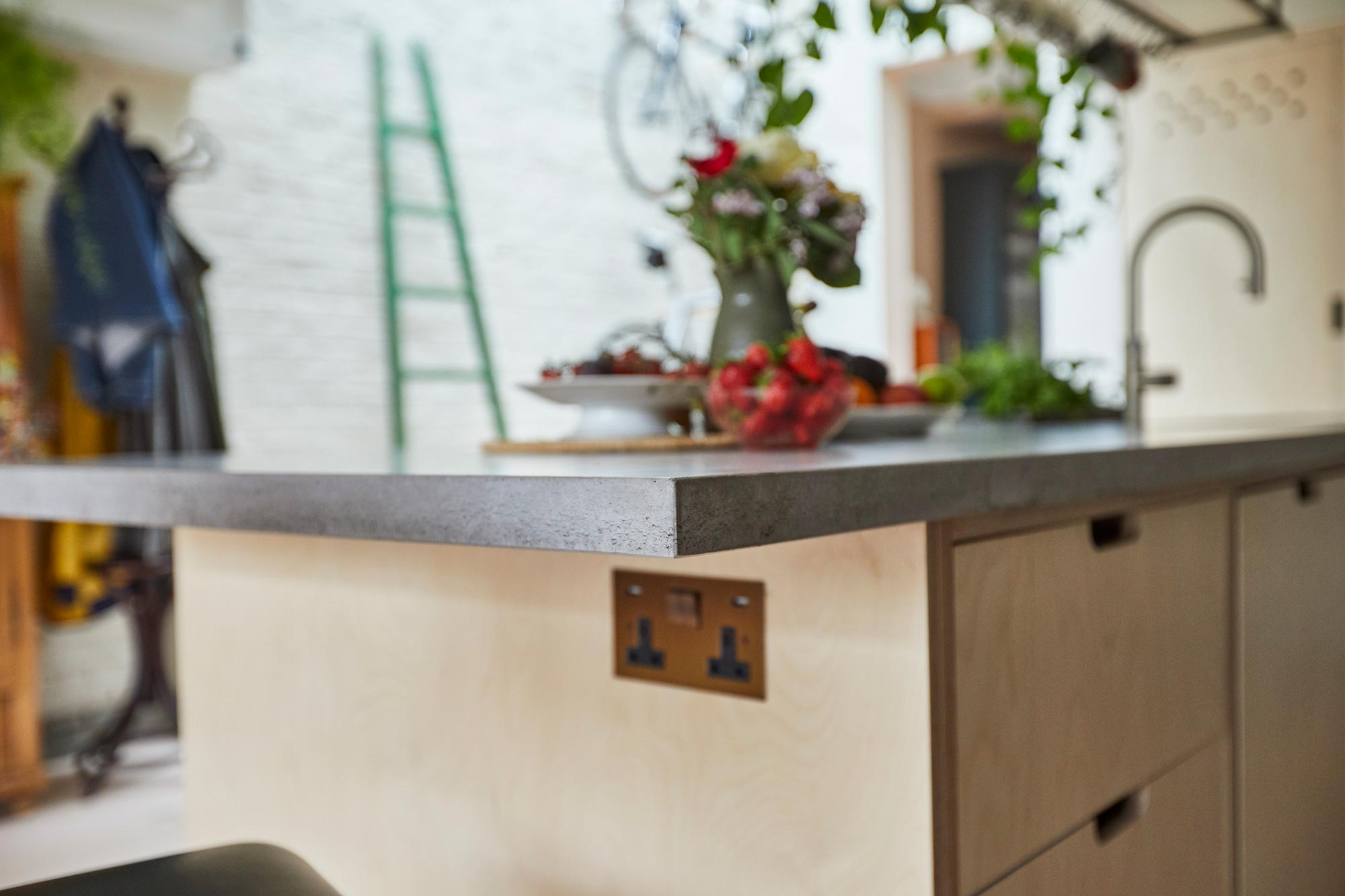 Solid concrete worktop on bespoke plywood kitchen island