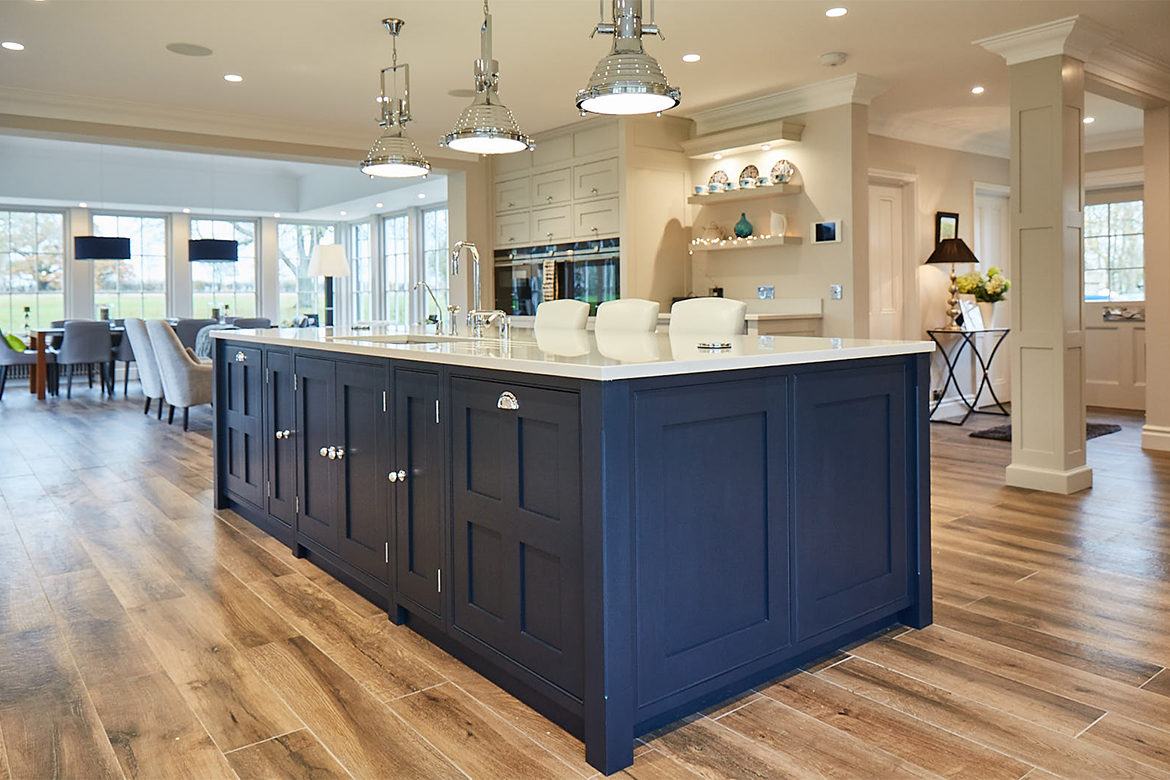 Georgian four panel shaker cabinet doors on island painted Little Greene blue with chrome cup handles