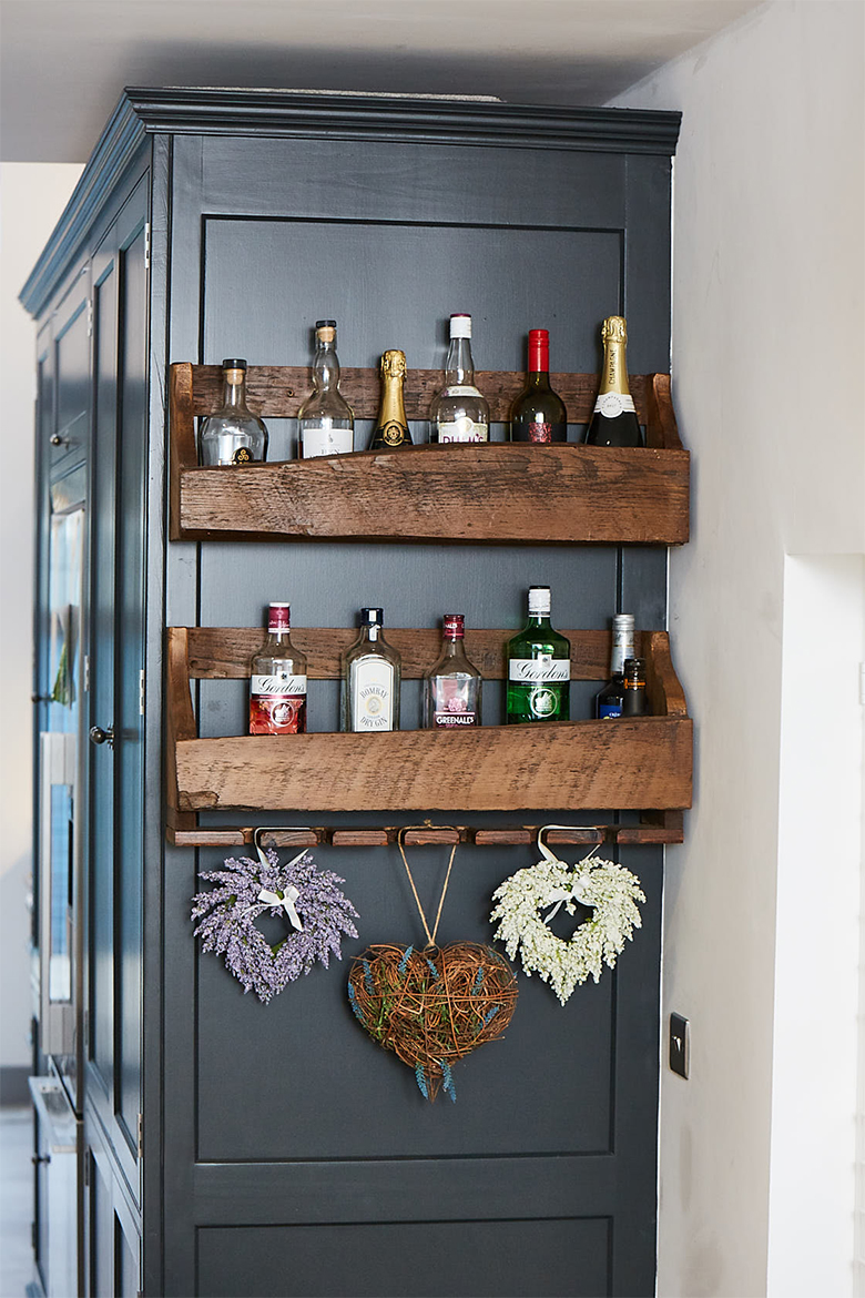 Rustic reclaimed pine wood gin holder with hanging hearts