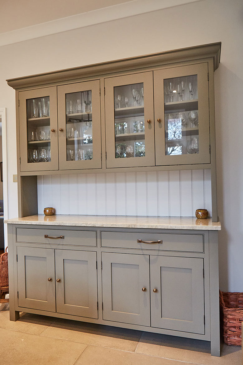 Freestanding grey moss dresser with painted white tongue and groove back boards