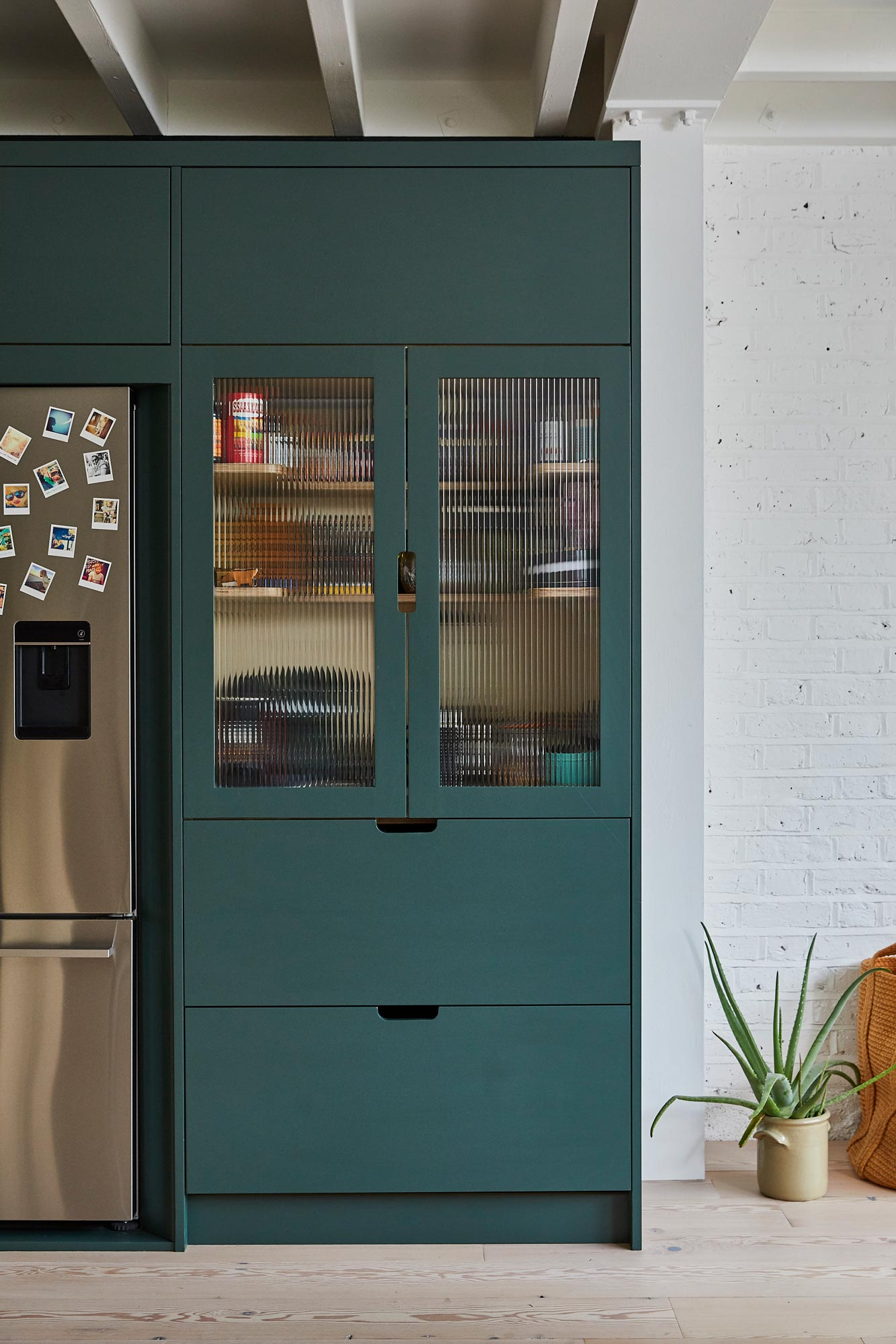 Dark green pantry unit with fluted glass and pan drawers