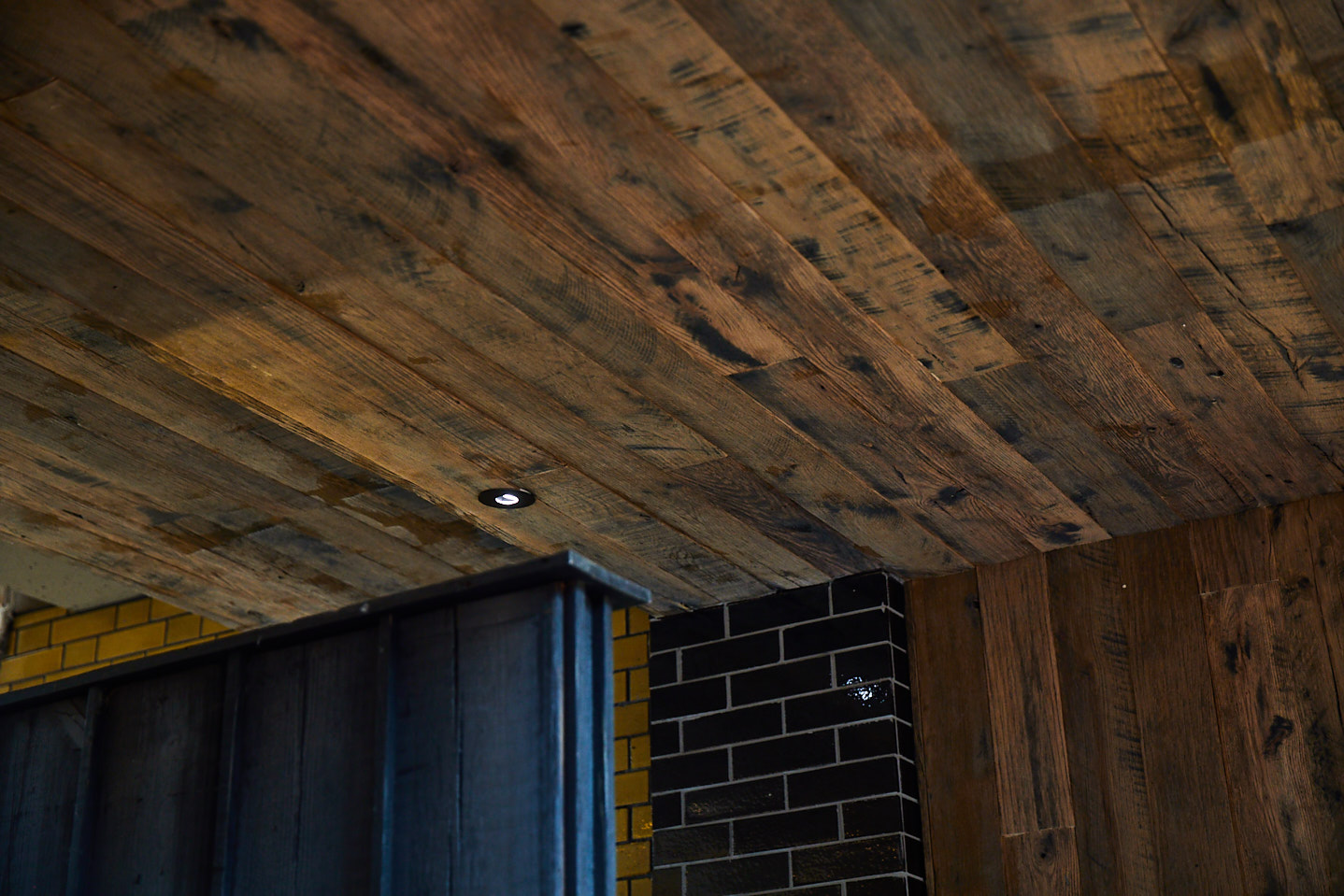 Reclaimed oak ceiling with integrated down lights
