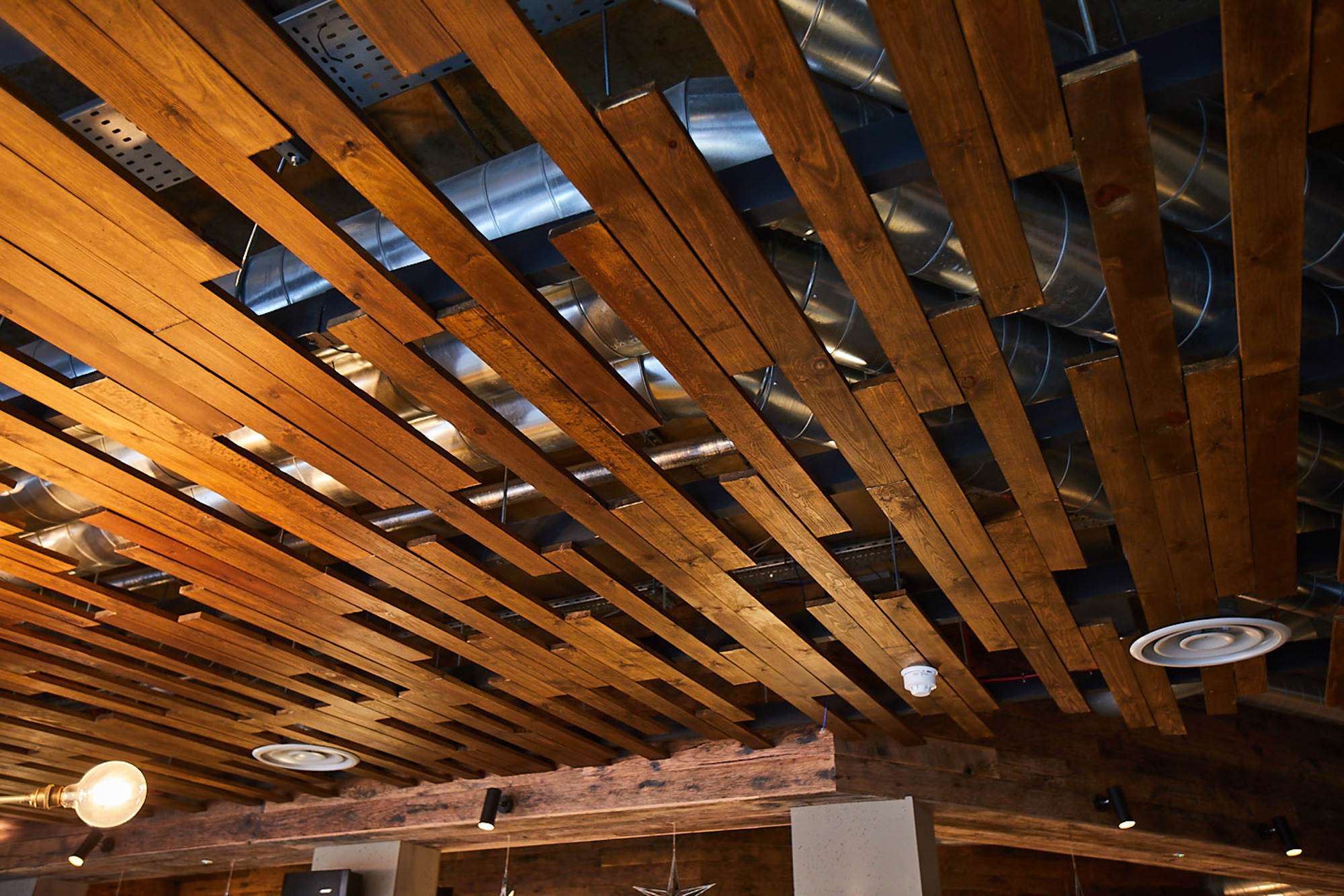 Oak wood planks used as eatery ceiling