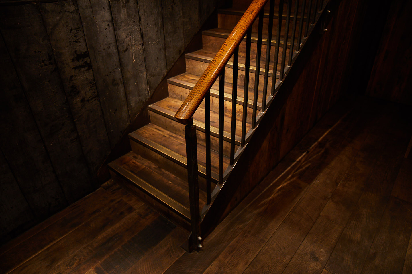 Rustic staircase with raw steel capping and oak handrail