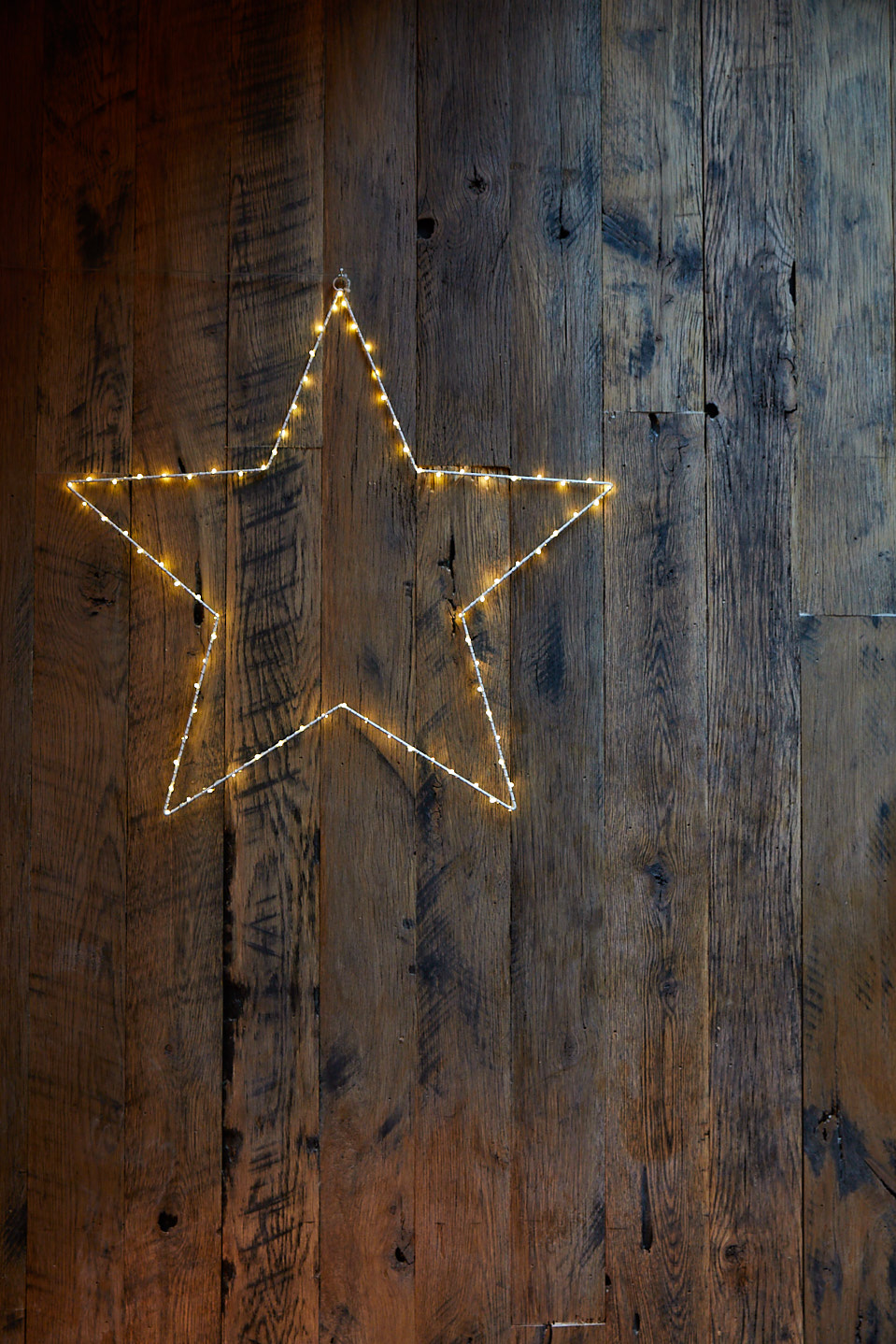 Fairy light star against rustic reclaimed wood wall