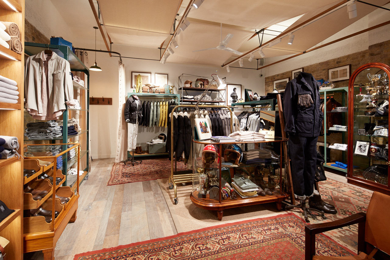 Belstaff interior with original furniture displaying clothing