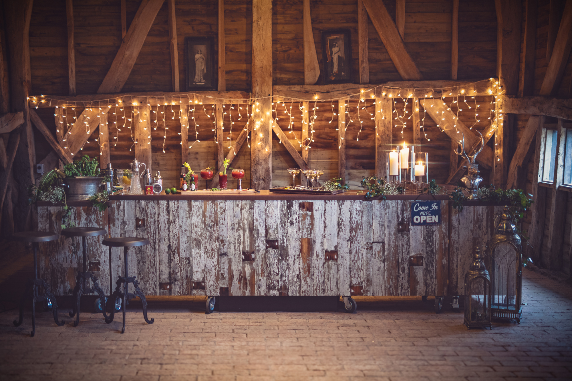 Fairy lights behind distressed wooden bar
