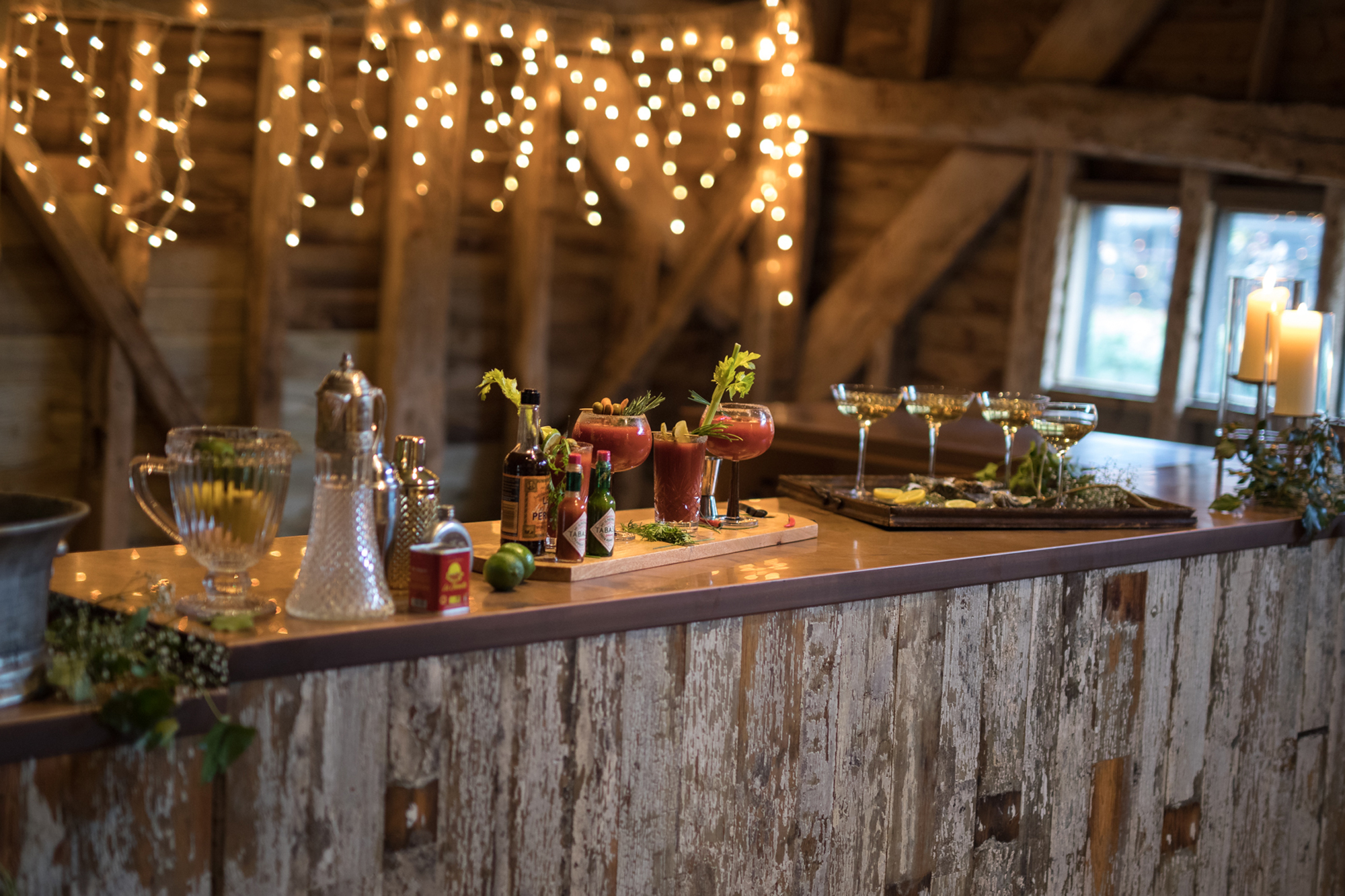 Reclaimed bar with fruit and cocktail shakers sat on copper worktop