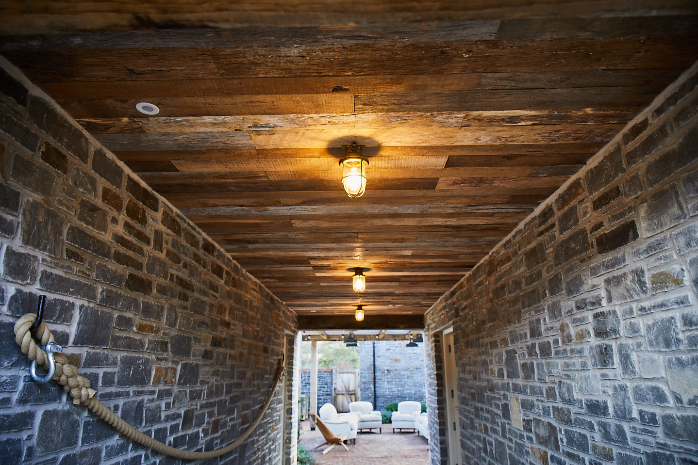 Reclaimed oak cladding used for ceiling in external corridor