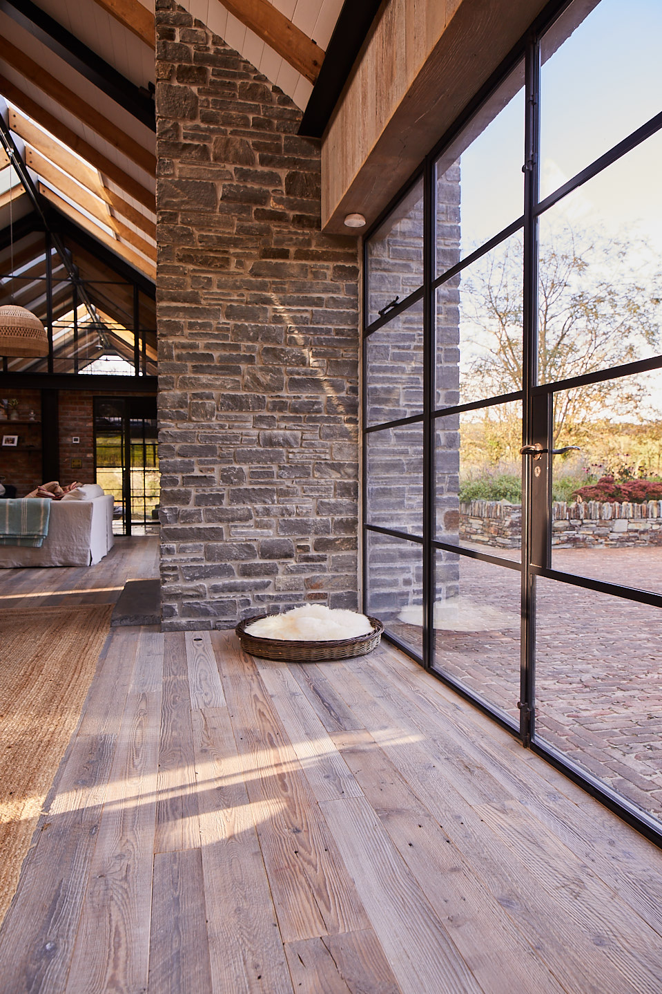 Crittall glass wall with reclaimed oak flooring
