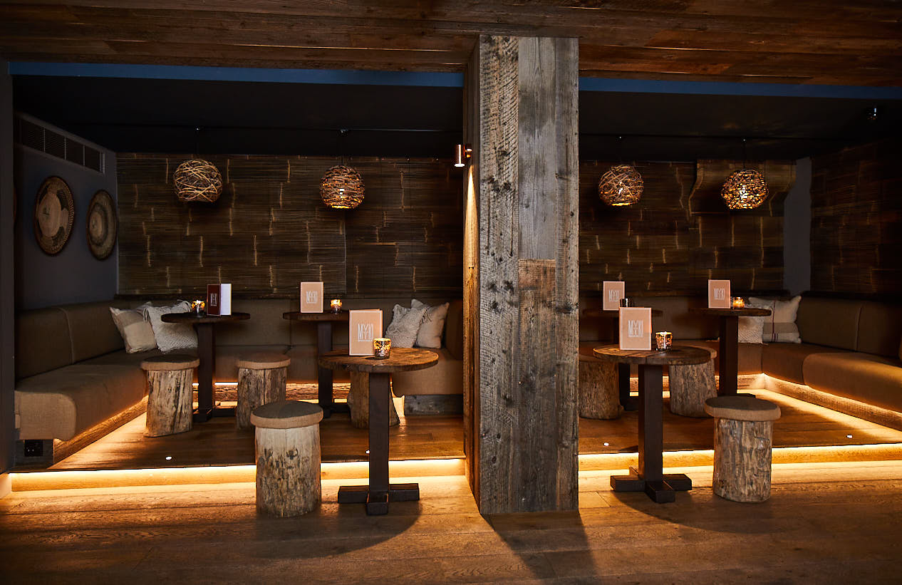 Large cladded rustic beam with seating area around