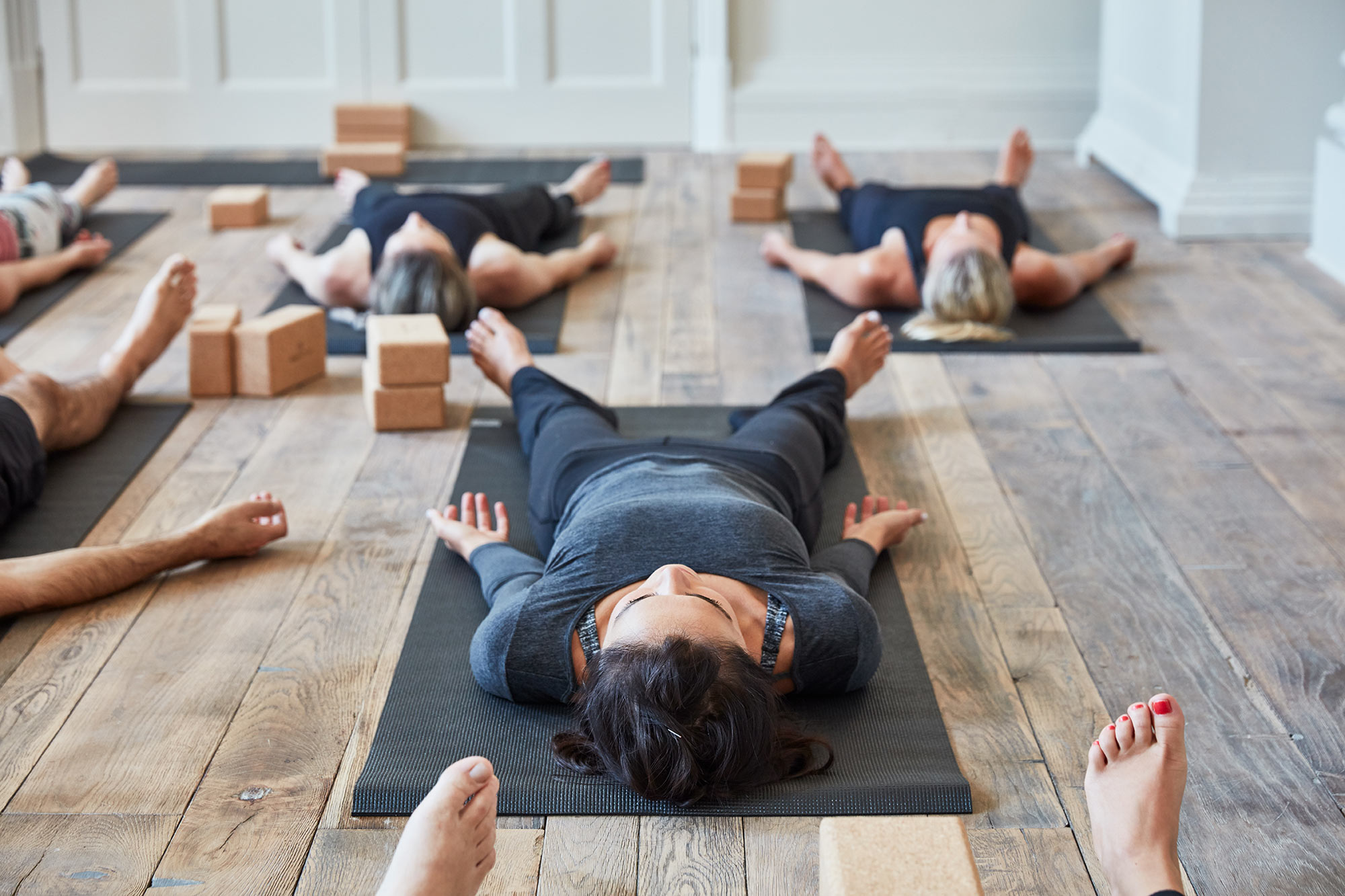 Yoga class on reclaimed oak floor