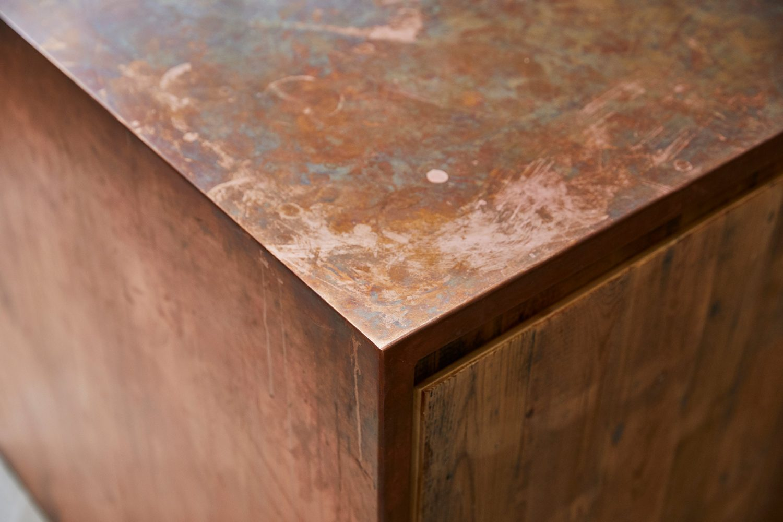 Raw copper worktop with pine door