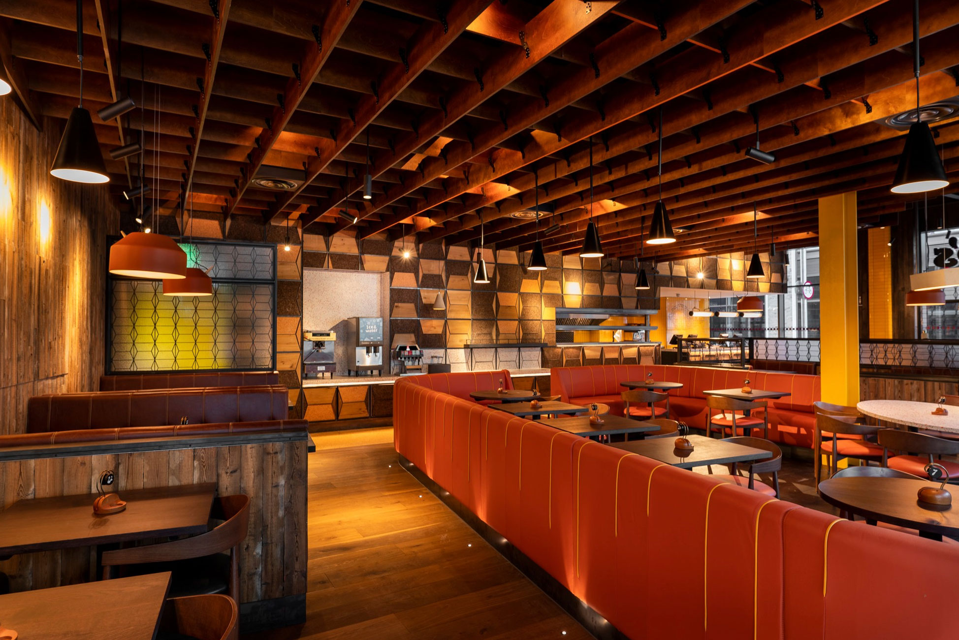 Nando's eatery interior with leather booths and wood cladding