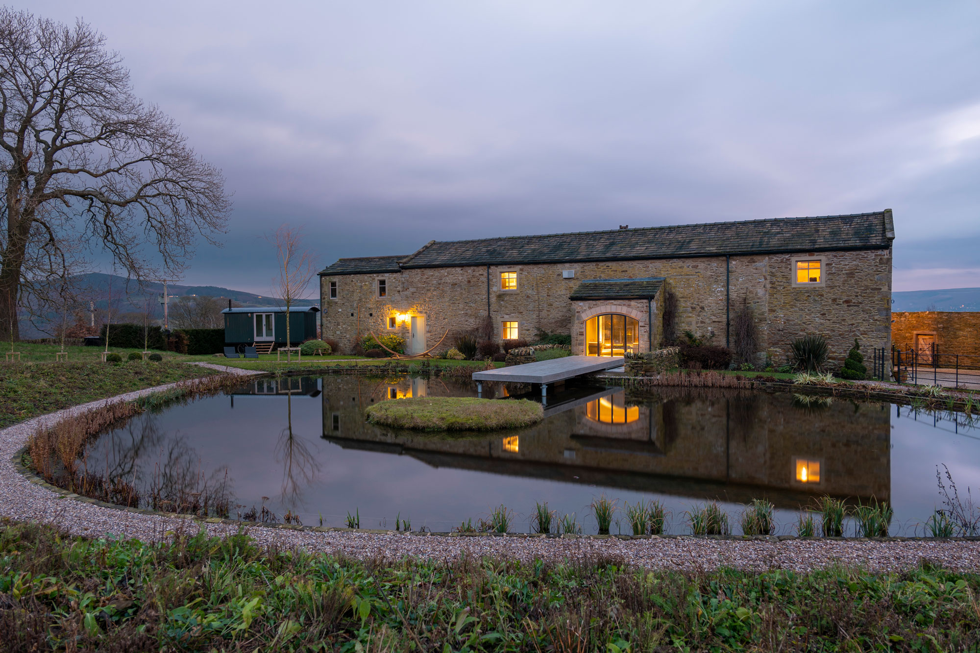 Stone farmhouse building with moat around