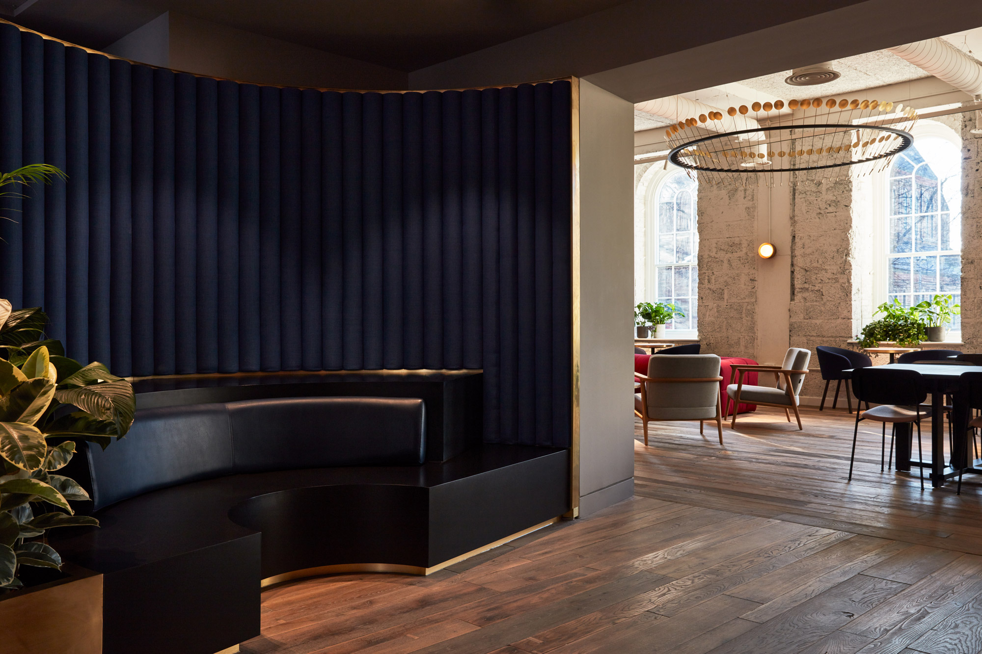 Black leather booth with blue headboard and engineered oak floorboards