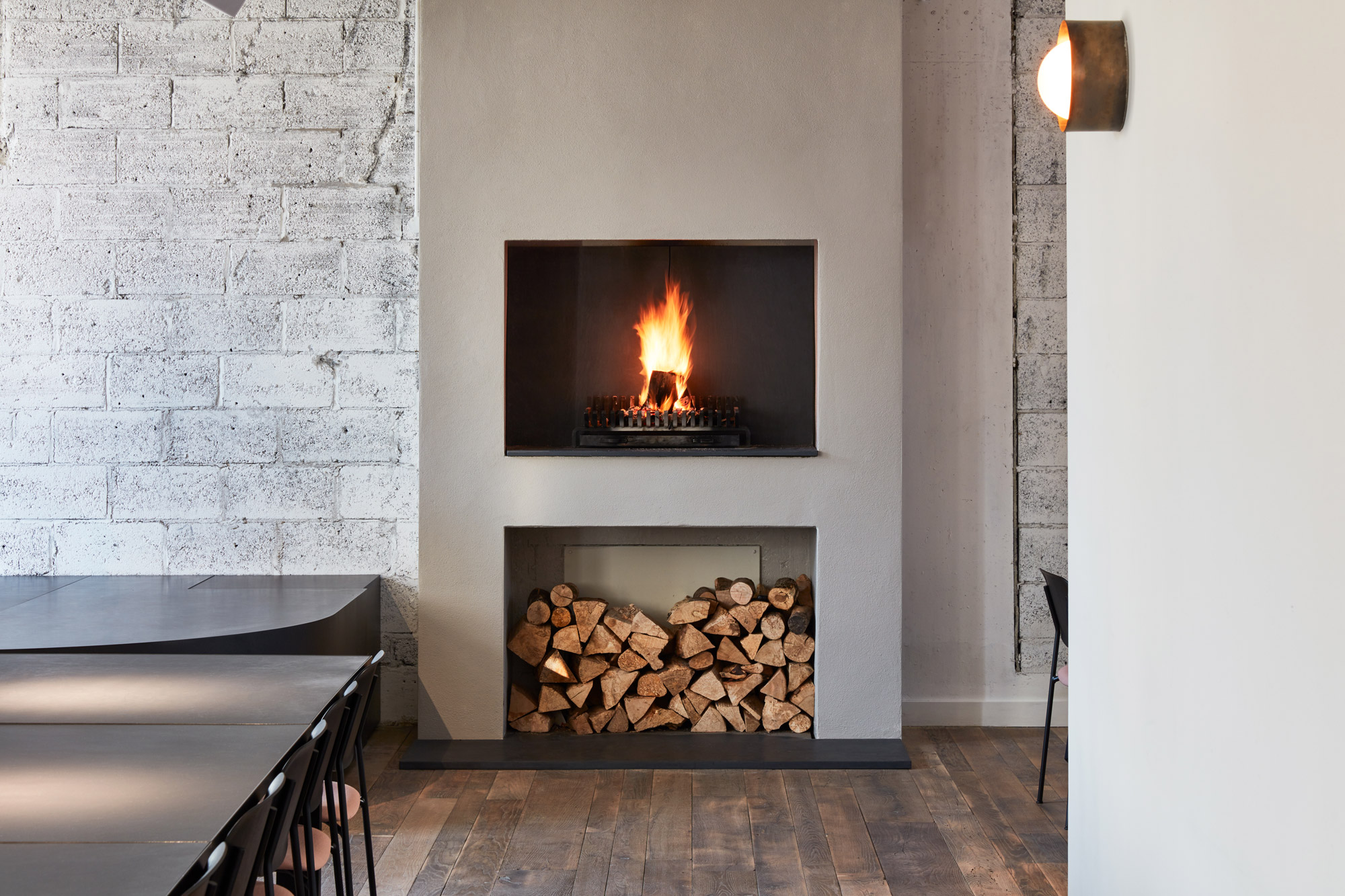 Concrete fireplace with log storage below