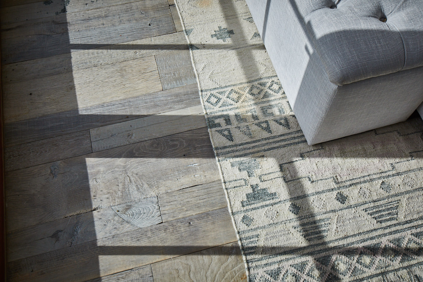 Light shining across reclaimed oak floorboards