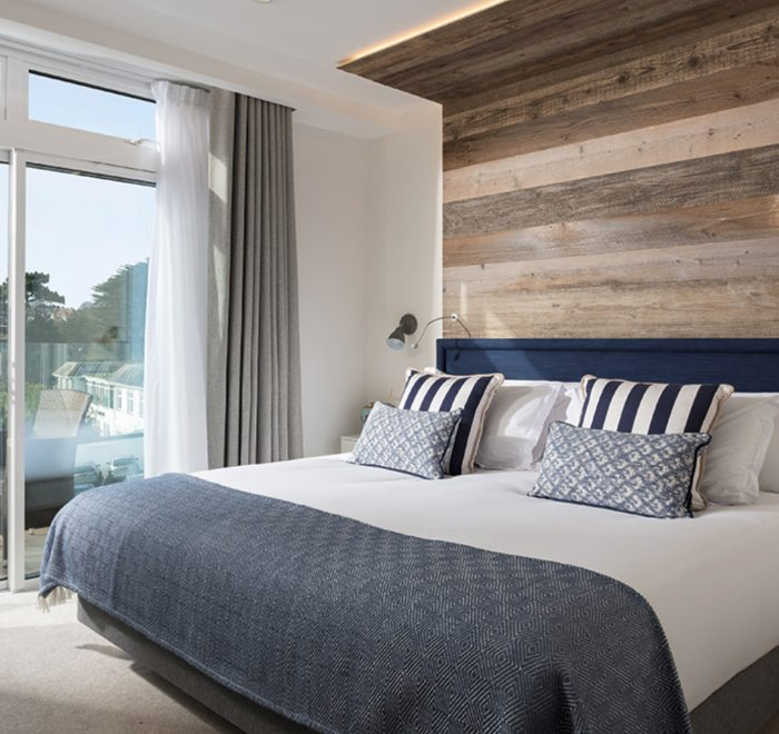 Reclaimed rustic cladding on headboard overlooking scenic view