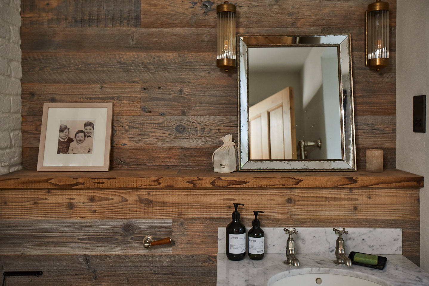 Reclaimed spruce wood wall cladding with freestanding vanity