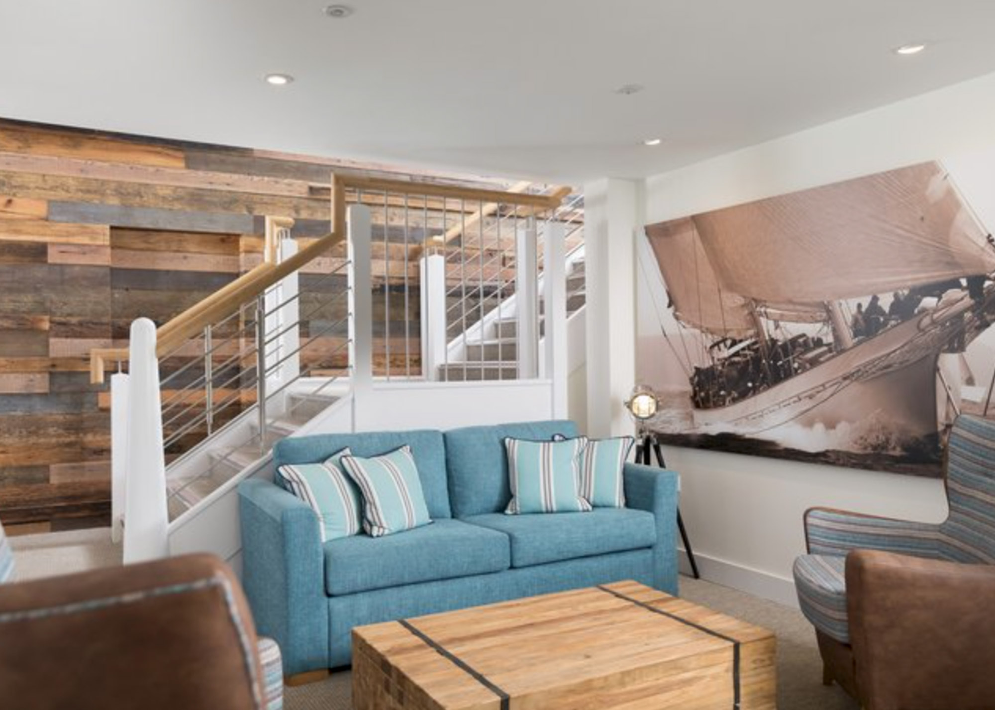 Turquoise sofa in living room with large reclaimed create coffee box