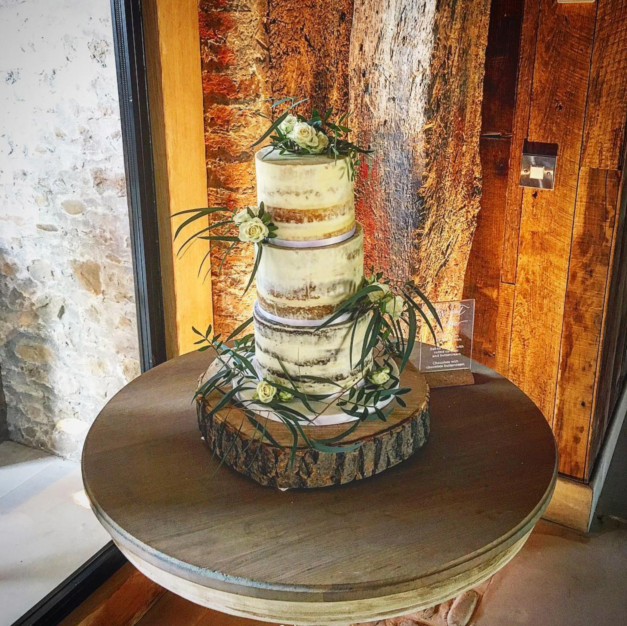 Wedding cake with rustic oak base